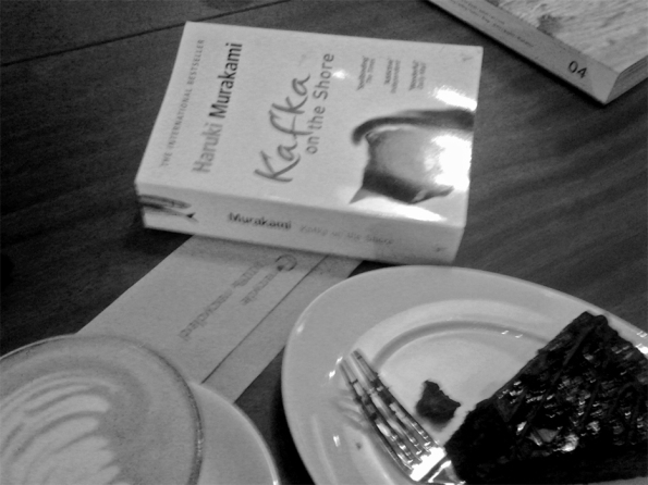 Murakami's 'Kafka On the Shore' with my cake. What I was originally reading (and which the woman behind the cashier desk gave two thumbs up to!)